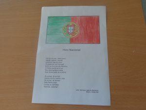 Página com bandeira portuguesa e poema