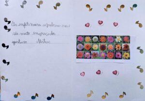 Um postal terminado com notas musicais e colagens de flores que diz: Os enfermeiros ajudam-nos, são muito engraçados.