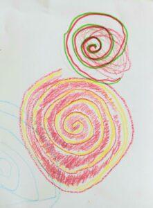 Um trabalho de um aluno onde se vê representas duas espirais pintadas no seu interior.